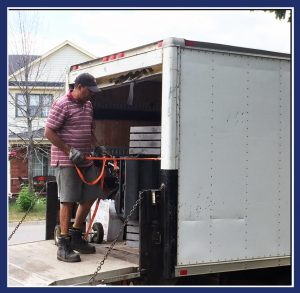 """Mike Reynos, President of Scrap for Food, strapping my barbecue in the truck. (Image: """"SoS"""")"""