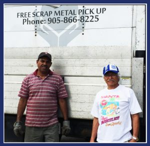 "Mike Reynos (left) and Humberto Baque of Scrap for Food, stop for a quick photo. (Image: ""SoS"")(Image: ""SoS"")"